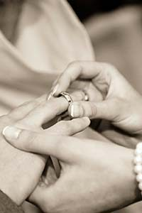 Putting ring on finger in wedding ceremony