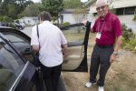 George Garrett helps Karon Peers get into Garrett's car before he takes her to a doctor appointment in Surrey.
