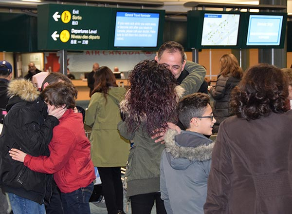 Syrian Refugee Family Arrives at the Vancouver Airport and is welcomed by family members already in Canada